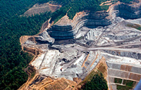As much as 600 feet of a mountain has been removed to access a narrow coal seam below
